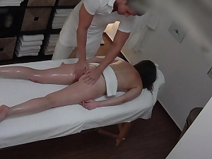 Youthful Black-haired with Glasses Seducted on Massage Table
