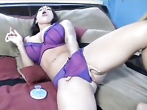 Hot superslut in her gorgeous lingerie fingerblasting pussy while licking on sofa