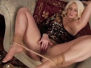 Stylish cougar in sheer stockings fingering her labia crevice hard core