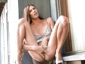 Naughty lady on high high-heeled slippers posing on sextape kneading her pussy