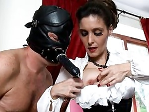 Insane man is wearing a ebony leather mask fucking her facehole