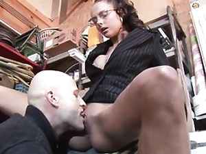 Geeky looking stunner gets beaten in various poses in the shed