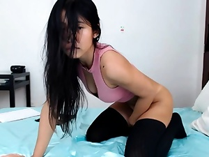 Beautiful chinese brown-haired youthful camgirl displaying on webcam