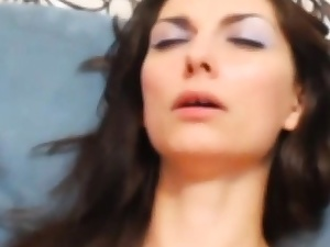 dark-haired shows  tasty face having plaything ejaculation